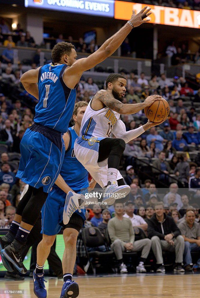 Denver Nuggets guard <a gi-track='captionPersonalityLinkClicked' href=/galleries/search?phrase=D.J.+Augustin&family=editorial&specificpeople=3847521 ng-click='$event.stopPropagation()'>D.J. Augustin</a> (12) flies through the air under Dallas Mavericks guard <a gi-track='captionPersonalityLinkClicked' href=/galleries/search?phrase=Justin+Anderson+-+Joueur+de+basketball&family=editorial&specificpeople=13887915 ng-click='$event.stopPropagation()'>Justin Anderson</a> (1) during the second quarter March 28, 2016 at Pepsi Center.