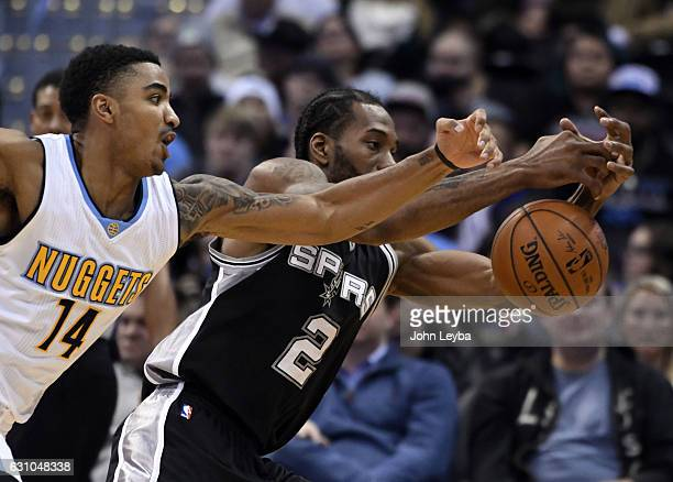 Denver Nuggets guard Gary Harris almost gets his hand on the ball as San Antonio Spurs forward Kawhi Leonard reaches out to grab the pass during the...