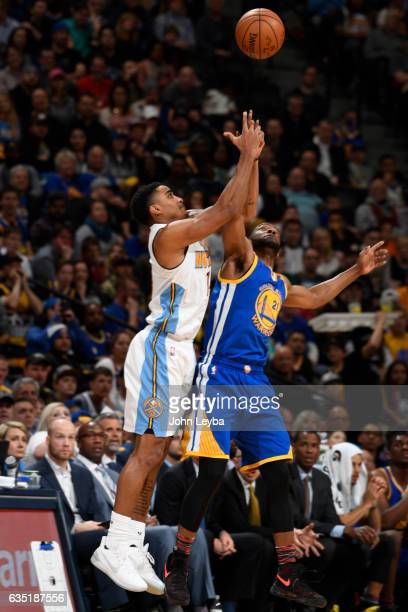 Denver Nuggets guard Gary Harris and Golden State Warriors guard Ian Clark battle for a rebound during the fourth quarter February 13 2017 at Pepsi...