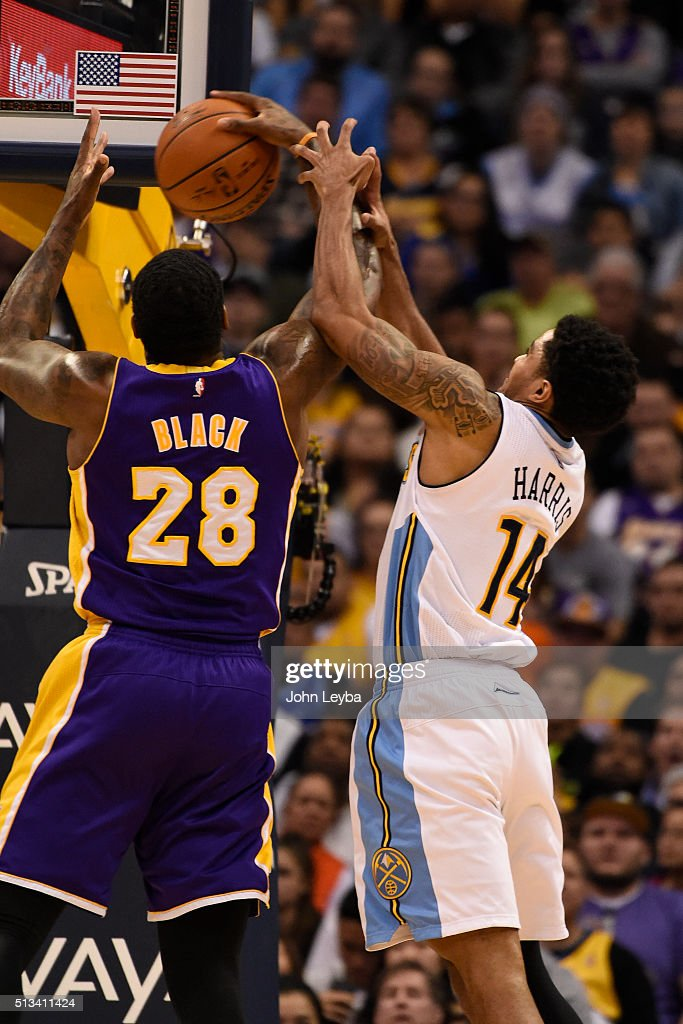 Denver Nuggets guard <a gi-track='captionPersonalityLinkClicked' href=/galleries/search?phrase=Gary+Harris+-+Basketball+Player&family=editorial&specificpeople=10612733 ng-click='$event.stopPropagation()'>Gary Harris</a> (14) battles for a rebound with Los Angeles Lakers center <a gi-track='captionPersonalityLinkClicked' href=/galleries/search?phrase=Tarik+Black&family=editorial&specificpeople=7338172 ng-click='$event.stopPropagation()'>Tarik Black</a> (28) March 2, 2016 at Pepsi Center.