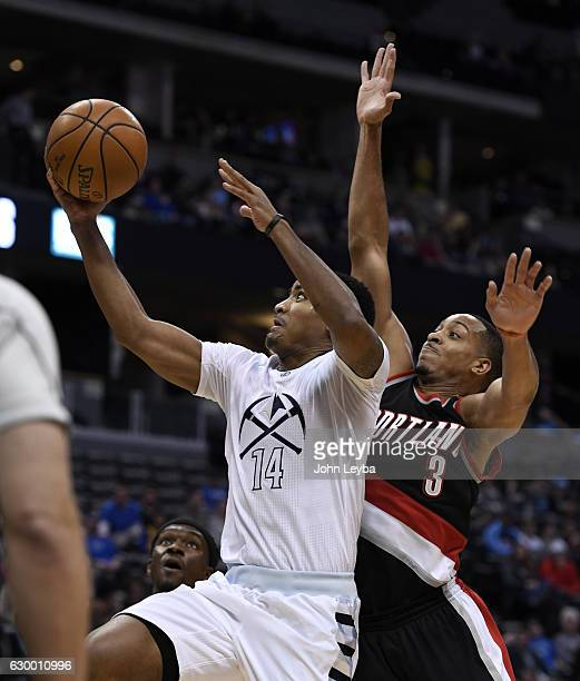 Denver Nuggets guard Gary Harris drives to the basket against Portland Trail Blazers guard CJ McCollum December 15 2016 at Pepsi Center