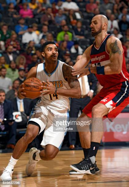 Denver Nuggets guard Gary Harris drives to the basket on Washington Wizards center Marcin Gortat during the first quarter on March 8 2017 in Denver...