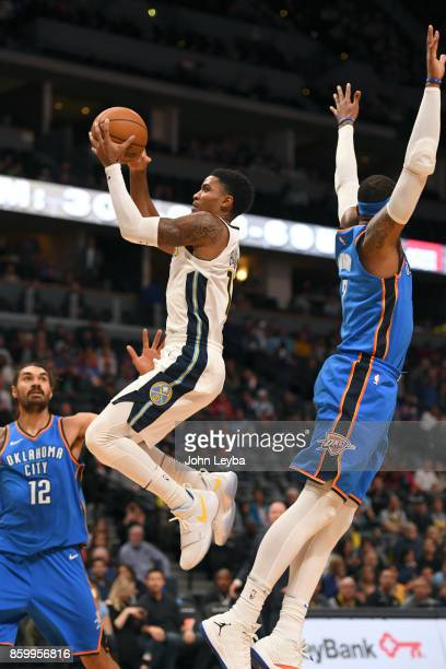 Denver Nuggets guard Gary Harris flies pas Oklahoma City Thunder forward Carmelo Anthony for an easy layup during the the first quarter on October 10...