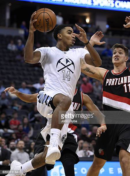 Denver Nuggets guard Gary Harris flies through air as he makes a pass to the outside against the Portland Trail Blazers December 15 2016 at Pepsi...