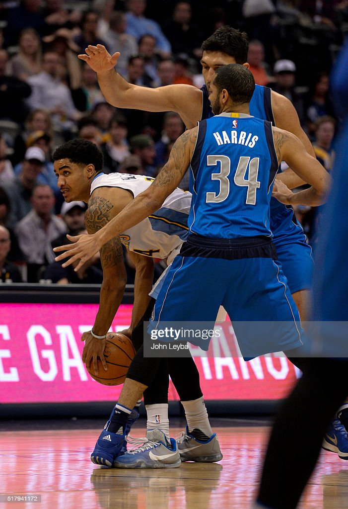 Denver Nuggets guard <a gi-track='captionPersonalityLinkClicked' href=/galleries/search?phrase=Gary+Harris+-+Basketball+Player&family=editorial&specificpeople=10612733 ng-click='$event.stopPropagation()'>Gary Harris</a> (14) gets trapped by Dallas Mavericks center <a gi-track='captionPersonalityLinkClicked' href=/galleries/search?phrase=Zaza+Pachulia&family=editorial&specificpeople=202939 ng-click='$event.stopPropagation()'>Zaza Pachulia</a> (27) and Dallas Mavericks guard <a gi-track='captionPersonalityLinkClicked' href=/galleries/search?phrase=Devin+Harris&family=editorial&specificpeople=202195 ng-click='$event.stopPropagation()'>Devin Harris</a> (34) during the first quarter March 28, 2016 at Pepsi Center.