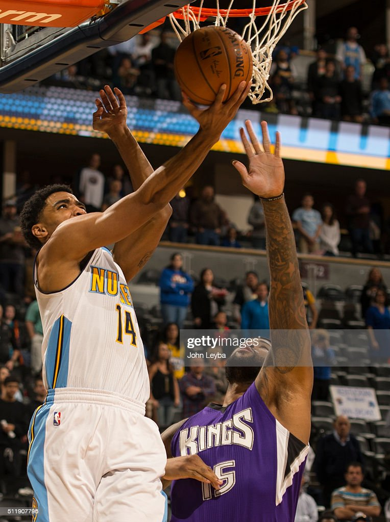 Denver Nuggets guard <a gi-track='captionPersonalityLinkClicked' href=/galleries/search?phrase=Gary+Harris+-+Basketball+Player&family=editorial&specificpeople=10612733 ng-click='$event.stopPropagation()'>Gary Harris</a> (14) goes up for a reverse layup past Sacramento Kings center <a gi-track='captionPersonalityLinkClicked' href=/galleries/search?phrase=DeMarcus+Cousins&family=editorial&specificpeople=5792008 ng-click='$event.stopPropagation()'>DeMarcus Cousins</a> (15) February 23, 2016 at Pepsi Center.