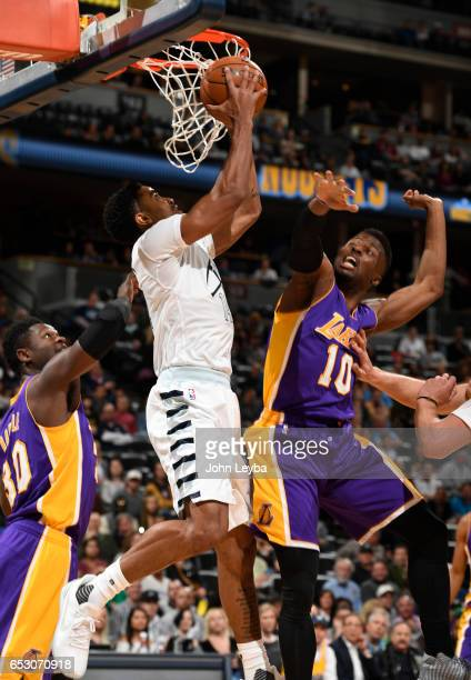 Denver Nuggets guard Gary Harris goes up for a shot as Los Angeles Lakers guard David Nwaba comes in on defense during the first quarter on March 13...