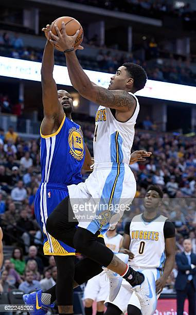 Denver Nuggets guard Gary Harris goes up for a shot on Golden State Warriors forward Kevin Durant during the firs tuqarter November 10 2016 at Pepsi...