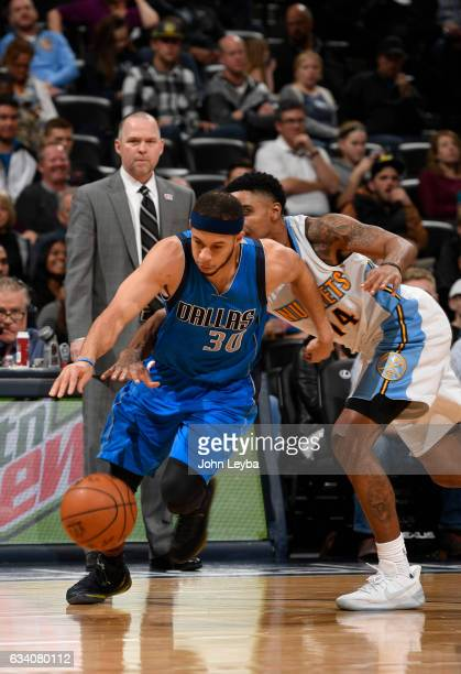 Denver Nuggets guard Gary Harris reaches in on Dallas Mavericks guard Seth Curry from behind during the fourth quarter February 6 2017 at Pepsi Center