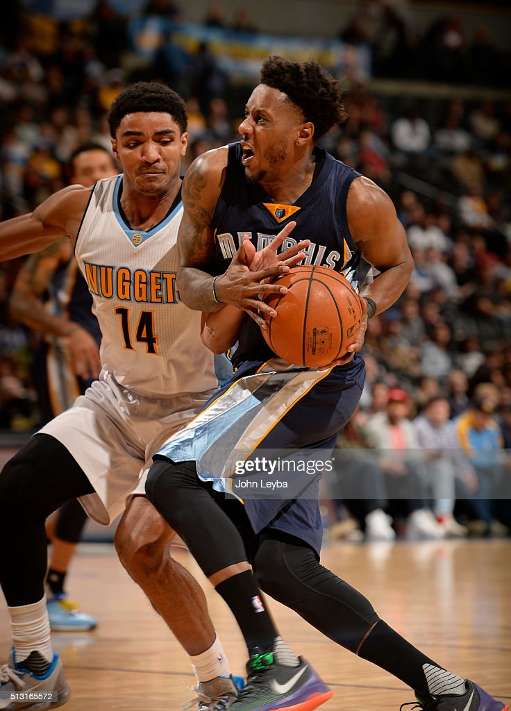 Denver Nuggets guard <a gi-track='captionPersonalityLinkClicked' href=/galleries/search?phrase=Gary+Harris+-+Basketball+Player&family=editorial&specificpeople=10612733 ng-click='$event.stopPropagation()'>Gary Harris</a> (14) sticks his hand in on Memphis Grizzlies guard <a gi-track='captionPersonalityLinkClicked' href=/galleries/search?phrase=Mario+Chalmers&family=editorial&specificpeople=802115 ng-click='$event.stopPropagation()'>Mario Chalmers</a> (6) as he drives to the basket during th fourth quarter February 29, 2016 at Pepsi Center.