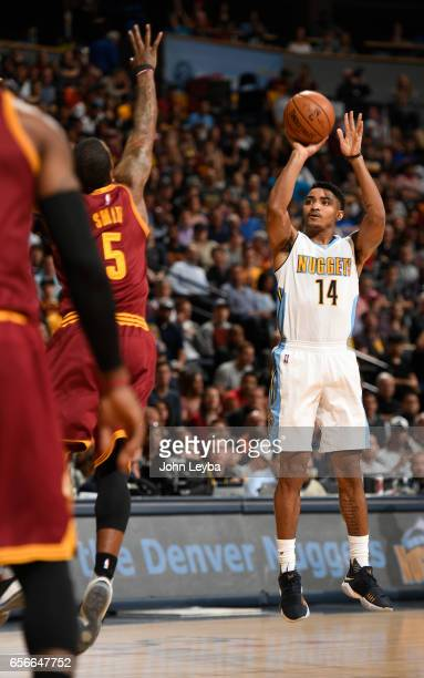 Denver Nuggets guard Gary Harris takes a shot over Cleveland Cavaliers guard JR Smith during the first quarter on March 22 2017 in Denver Colorado at...