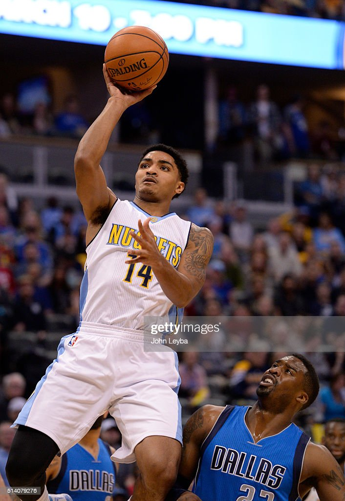 Denver Nuggets guard <a gi-track='captionPersonalityLinkClicked' href=/galleries/search?phrase=Gary+Harris+-+Basketball+Player&family=editorial&specificpeople=10612733 ng-click='$event.stopPropagation()'>Gary Harris</a> (14) takes a shot past Dallas Mavericks guard <a gi-track='captionPersonalityLinkClicked' href=/galleries/search?phrase=Wesley+Matthews+-+Basketball+Player&family=editorial&specificpeople=804816 ng-click='$event.stopPropagation()'>Wesley Matthews</a> (23) during the first quarter March 6, 2016 at Pepsi Center.