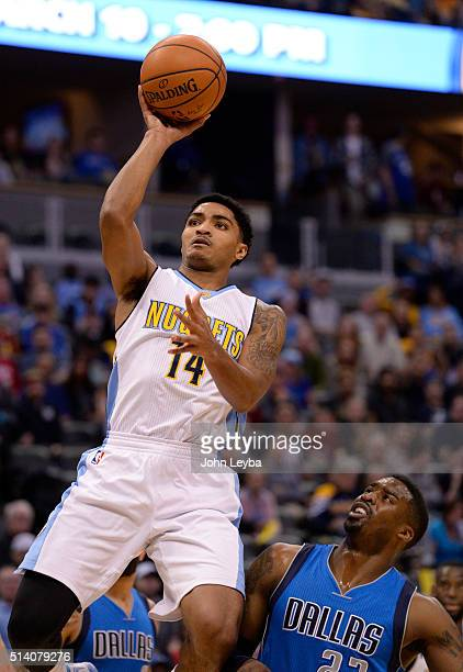 Denver Nuggets guard Gary Harris takes a shot past Dallas Mavericks guard Wesley Matthews during the first quarter March 6 2016 at Pepsi Center