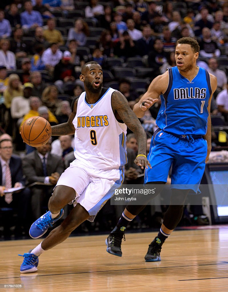 Denver Nuggets guard JaKarr Sampson (9) drives around Dallas Mavericks guard <a gi-track='captionPersonalityLinkClicked' href=/galleries/search?phrase=Justin+Anderson+-+Giocatore+di+basket&family=editorial&specificpeople=13887915 ng-click='$event.stopPropagation()'>Justin Anderson</a> (1) during the first quarter March 28, 2016 at Pepsi Center.