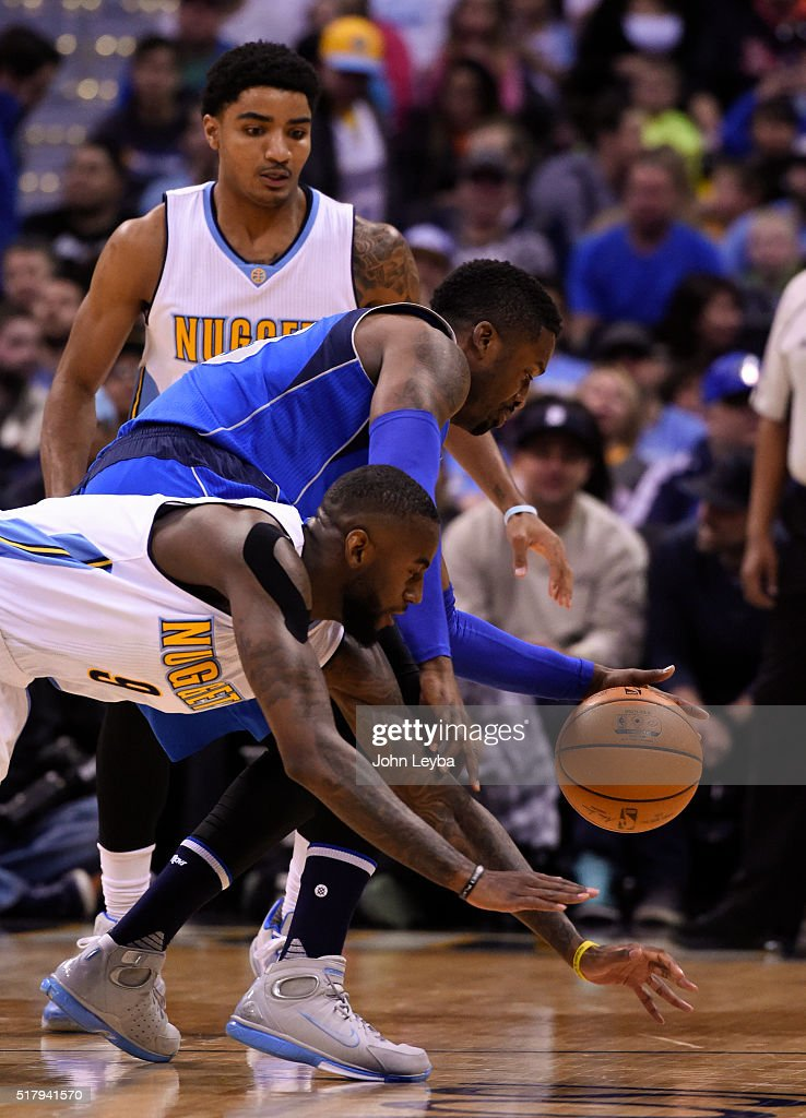 Denver Nuggets guard JaKarr Sampson (9) scrambles for a loose ball with Dallas Mavericks guard <a gi-track='captionPersonalityLinkClicked' href=/galleries/search?phrase=Wesley+Matthews+-+Basketball+Player&family=editorial&specificpeople=804816 ng-click='$event.stopPropagation()'>Wesley Matthews</a> (23) during the first quarter March 28, 2016 at Pepsi Center.