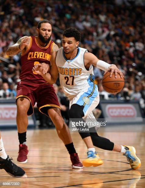 Denver Nuggets guard Jamal Murray drives on Cleveland Cavaliers guard Deron Williams during the second qurater on March 22 2017 in Denver Colorado at...