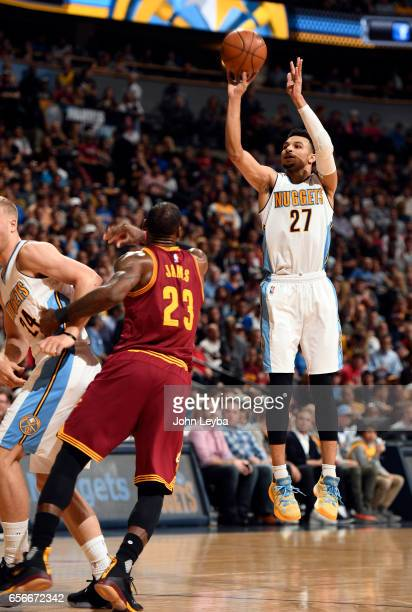 Denver Nuggets guard Jamal Murray hits a three pointer as Cleveland Cavaliers forward LeBron James watches during the second quarter on March 22 2017...