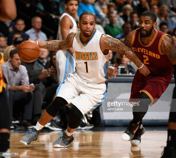 Denver Nuggets guard Jameer Nelson drives past Cleveland Cavaliers guard Kyrie Irving during the first quarter on March 22 2017 in Denver Colorado at...