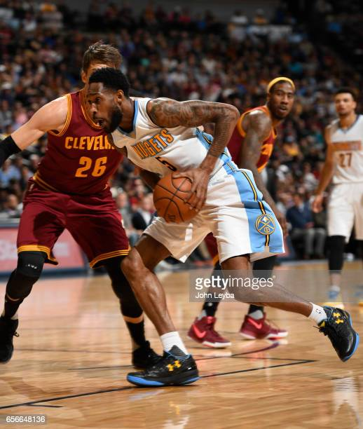 Denver Nuggets guard Will Barton drives on Cleveland Cavaliers guard Kyle Korver during the first quarter on March 22 2017 in Denver Colorado at...