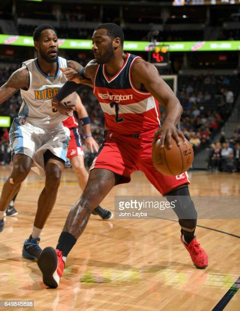 Denver Nuggets guard Will Barton forces Washington Wizards guard John Wall to the corner during the third quarter on March 8 2017 in Denver Colorado...