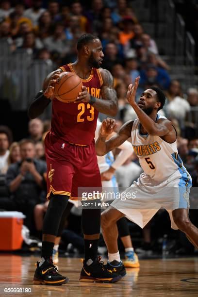 Denver Nuggets guard Will Barton guards Cleveland Cavaliers forward LeBron James during the second quarter on March 22 2017 in Denver Colorado at...
