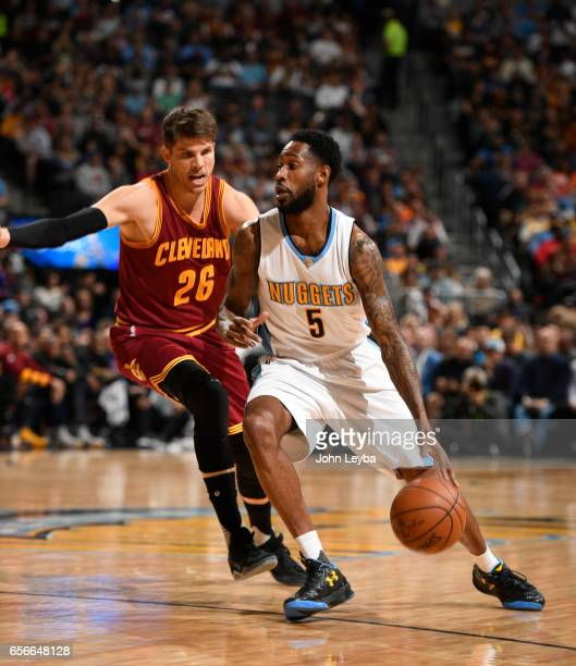 Denver Nuggets guard Will Barton looks to drive as Cleveland Cavaliers guard Kyle Korver comes in on defense during the first quarter on March 22...