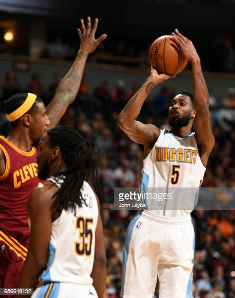 Denver Nuggets guard Will Barton takes a shot over Cleveland Cavaliers guard Iman Shumpert during the first quarter on March 22 2017 in Denver...