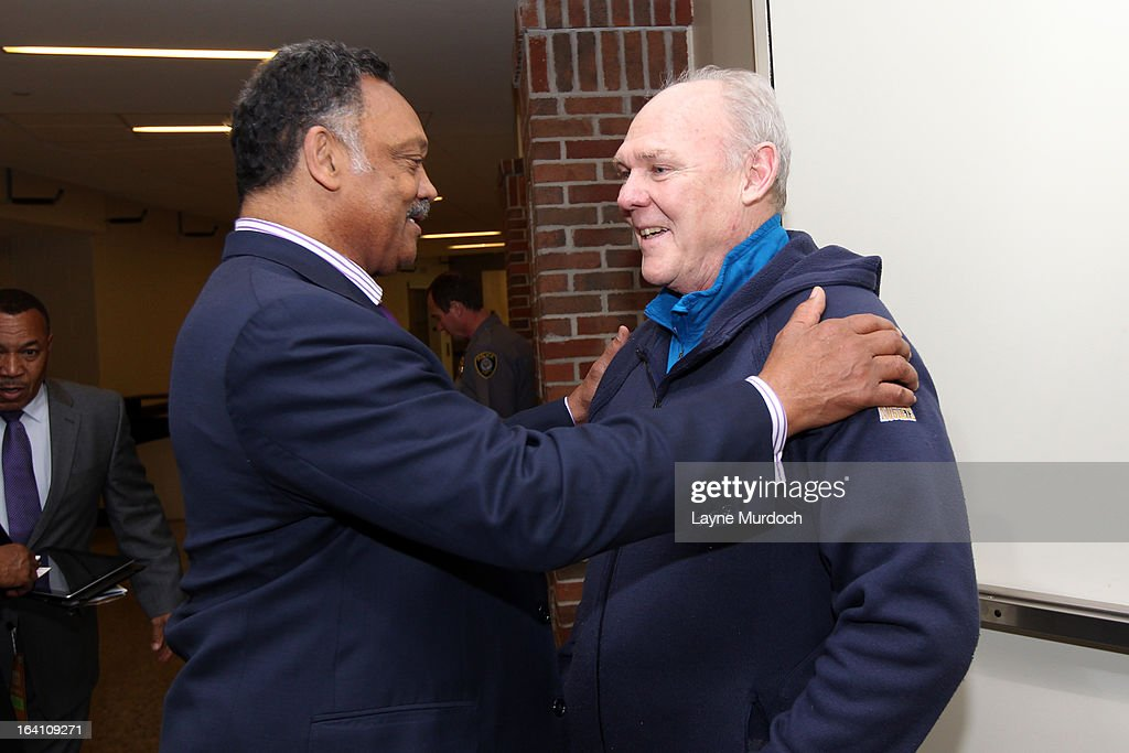 Denver Nuggets head coach George Karl greets Reverend Jesse Jackson during after an NBA game between the Oklahoma City Thunder and the Denver Nuggets on March 19, 2013 at the Chesapeake Energy Arena in Oklahoma City, Oklahoma.