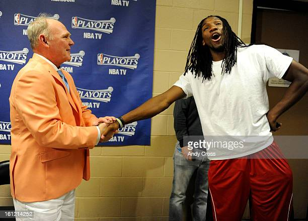 Denver Nuggets head coach George Karl sporting a Kentucky Derby outfit has a laugh with player Kenneth Faried after Karl spoke with reporters...