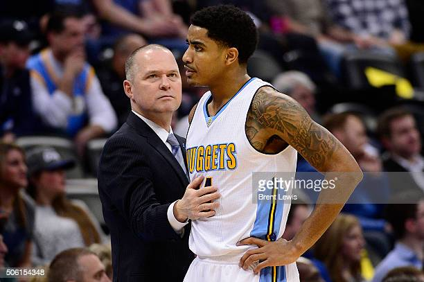 Denver Nuggets head coach Michael Malone pats guard Gary Harris on the stomach after he got hit with his second foul during the first quarter at the...