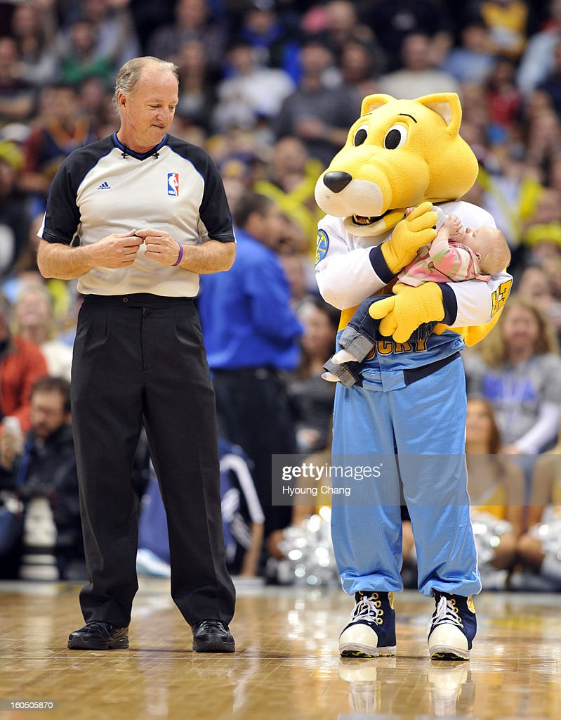 Denver Nuggets mascot Rocky, right, takes care of a young fan during the 2nd half of the game against New Orleans Hornets on February 1, 2013 at Pepsi Center in Denver, Colorado. Denver won 113-98.