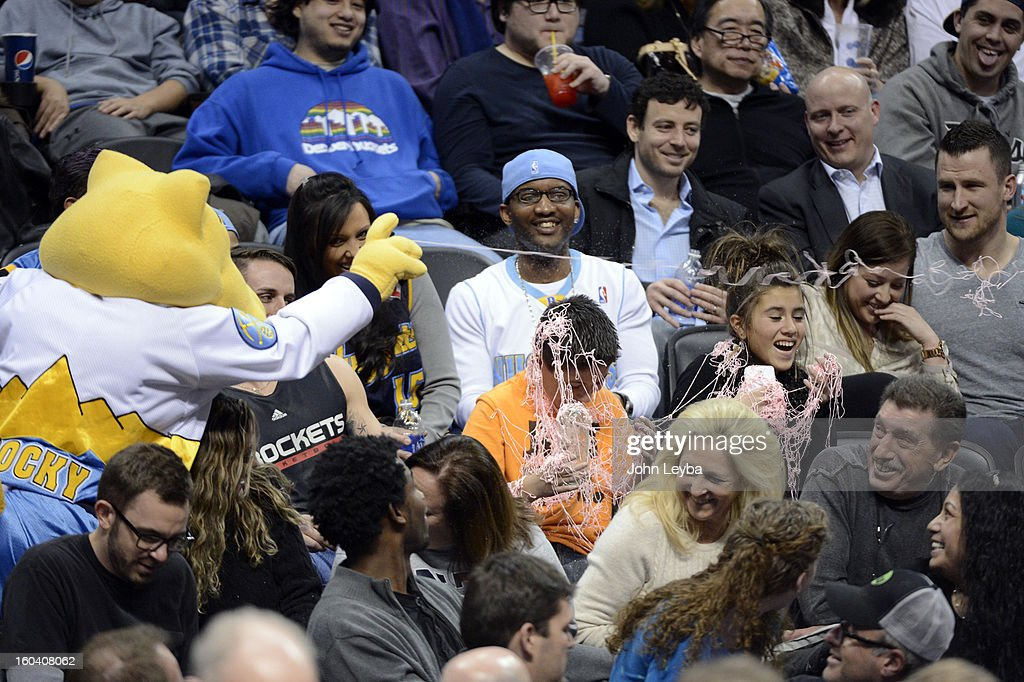 Denver Nuggets mascot Rocky sprays silly string on fans during the third quarter January 30, 2013 at Pepsi Center. The Denver Nuggets take on the Houston Rockets in NBA action.