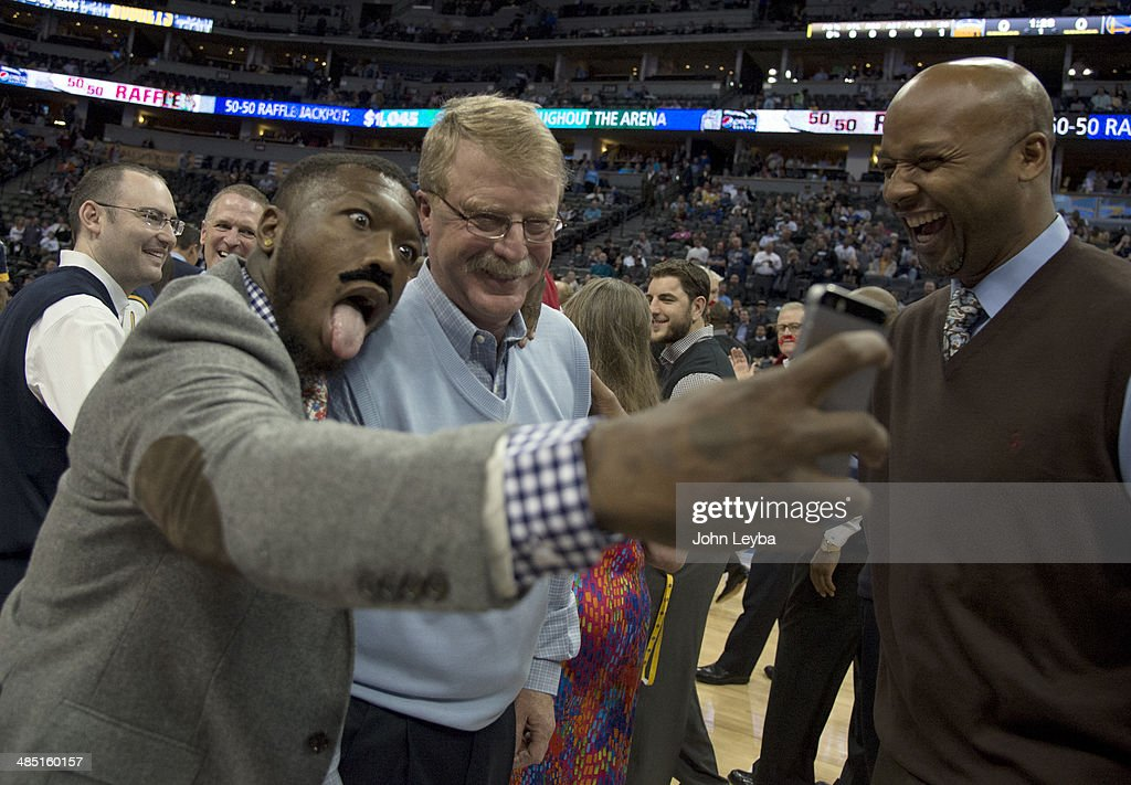 Denver Nuggets Nate Robinson takes a selfie with Denver Nuggets trainer Jim Gillen, who will retire after 23 seasons with the team April 16, 2014 at Pepsi Center. Denver Nuggets head coach Brian Shaw laughs during the selfie photo shoot.