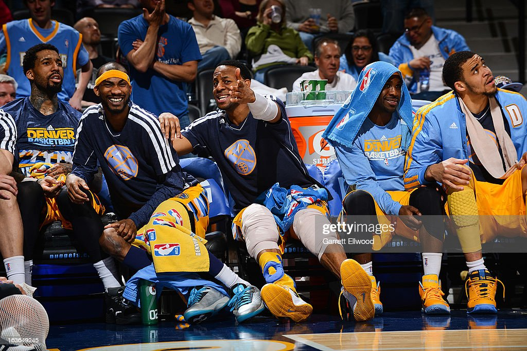 Denver Nuggets players, from left, Wilson Chandler #21, Corey Brewer #13, Andre Iguodala #9, Ty Lawson #3 and JaVale McGee #34 celebrate from the bench during a game against the New York Knicks on March 13, 2013 at the Pepsi Center in Denver, Colorado.