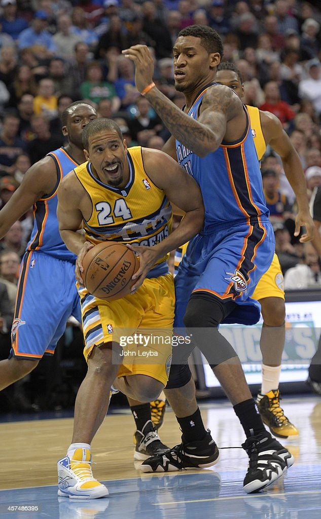 Denver Nuggets point guard Andre Miller (24) drives on Oklahoma City Thunder small forward Perry Jones (3) during the second quarter December 17, 2013 at Pepsi Center.