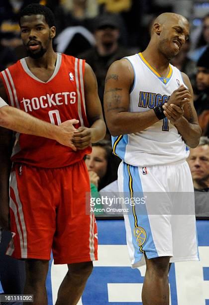 Denver Nuggets point guard Chauncey Billups rubs his wrist after getting fouled by Houston Rockets point guard Aaron Brooks during the second quarter...
