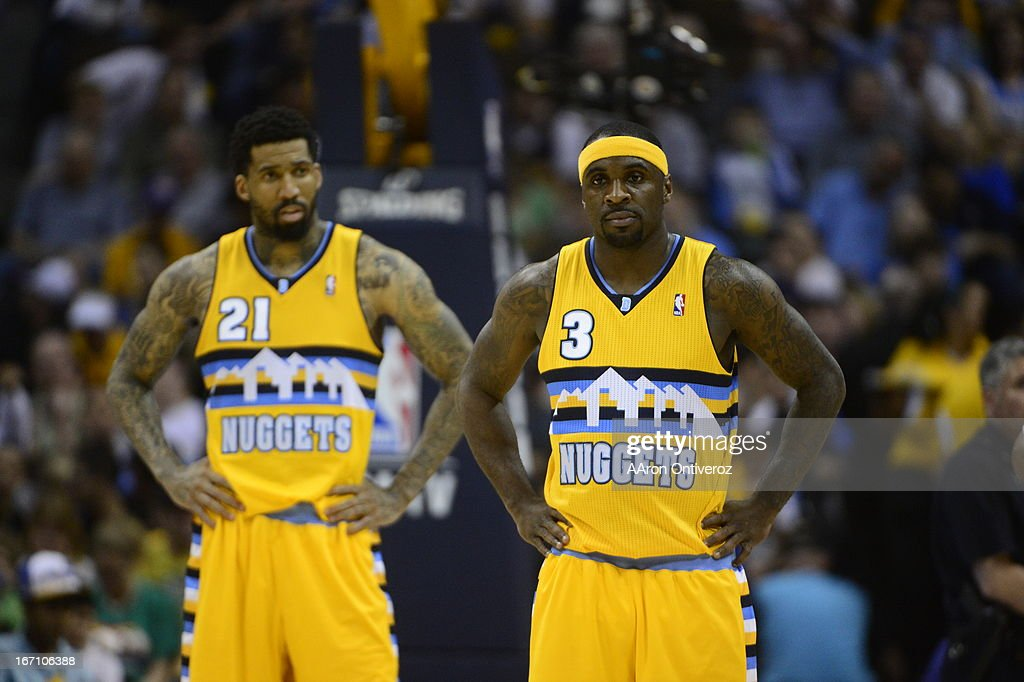Denver Nuggets point guard Ty Lawson (3) and Denver Nuggets shooting guard Wilson Chandler (21) wait for play to begin in the second quarter. The Denver Nuggets took on the Golden State Warriors in Game 1 of the Western Conference First Round Series at the Pepsi Center in Denver, Colo. on April 20, 2013.