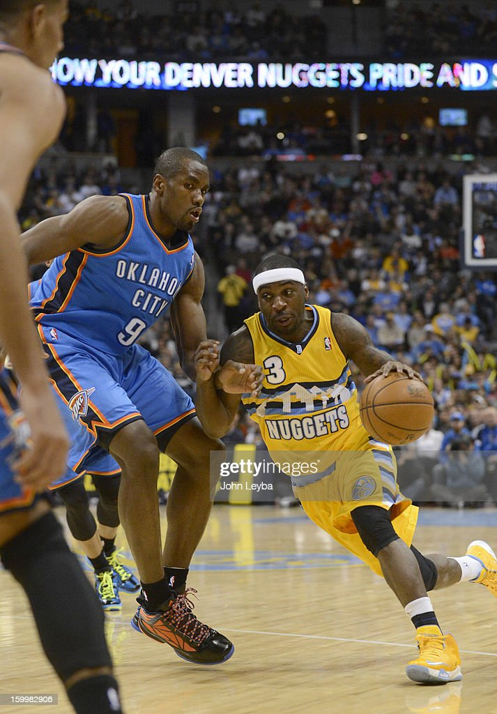 Denver Nuggets point guard Ty Lawson (3) drives on Oklahoma City Thunder power forward Serge Ibaka (9) during the first quarter January 20, 2013 at Pepsi Center.