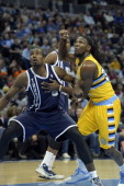 Denver Nuggets power forward Kenneth Faried battles for position with Oklahoma City Thunder power forward Serge Ibaka during the first quarter...