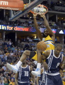 Denver Nuggets power forward Kenneth Faried gets an easy dunk pas Oklahoma City Thunder power forward Serge Ibaka during the first quarter January 9...