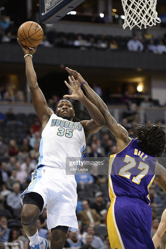 Denver Nuggets power forward Kenneth Faried takes a jump hook over Los Angeles Lakers center Jordan Hill during the first quarter November 13 2013 at...