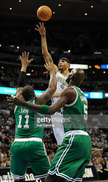 Denver Nuggets power forward Kenyon Martin put up a shot over Boston Celtics power forward Glen Davis and Boston Celtics power forward Kevin Garnett...