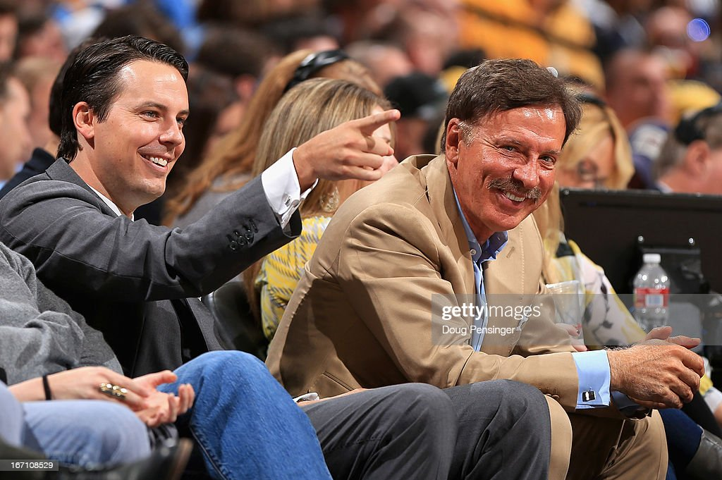 Denver Nuggets President Josh Kroenke and his father Stan Kroenke, the owner of the Denver Nuggets support their team from courtside seats as they face the Golden State Warriors during Game One of the Western Conference Quarterfinals of the 2013 NBA Playoffs at the Pepsi Center on April 20, 2013 in Denver, Colorado. The Nuggets defeated the Warriors 97-95.