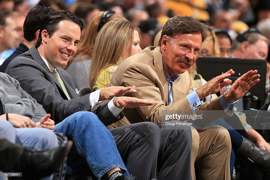 Denver Nuggets President Josh Kroenke and his father Stan Kroenke, the owner of the Denver Nuggets offer praise for Rocky, the team mascot, as they watch the game from courtside seats as the Nuggets face the Golden State Warriors during Game One of the Western Conference Quarterfinals of the 2013 NBA Playoffs at the Pepsi Center on April 20, 2013 in Denver, Colorado. The Nuggets defeated the Warriors 97-95.