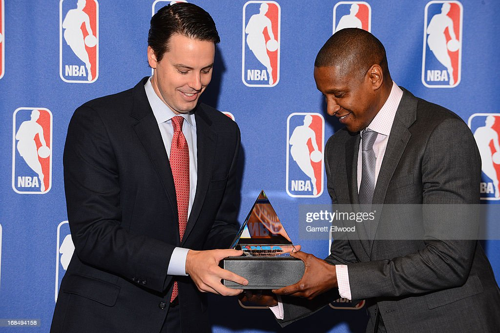 Denver Nuggets President Josh Kroenke presents Executive Vice President of Basketball Operations Masai Ujiri the award for being named 2012-2013 NBA Executive of the Year on May 9, 2013 at the Pepsi Center in Denver, Colorado.