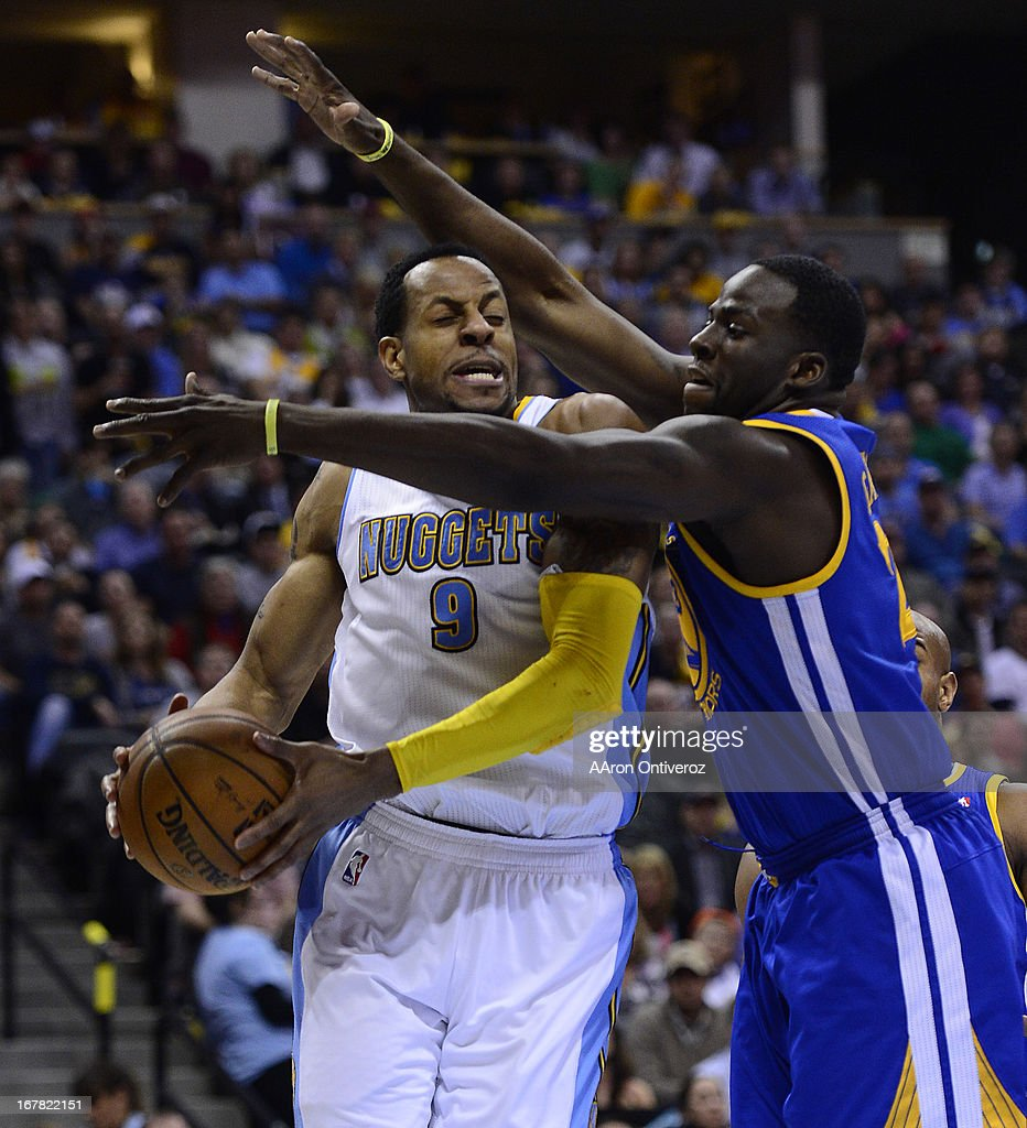 Denver Nuggets shooting guard Andre Iguodala (9) tries to drive around Golden State Warriors small forward Draymond Green (23). The Denver Nuggets took on the Golden State Warriors in Game 5 of the Western Conference First Round Series at the Pepsi Center in Denver, Colo. on April 30, 2013.