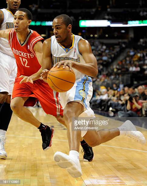 Denver Nuggets shooting guard Arron Afflalo drives past Houston Rockets shooting guard Kevin Martin during the first quarter on Monday January 3 2011...
