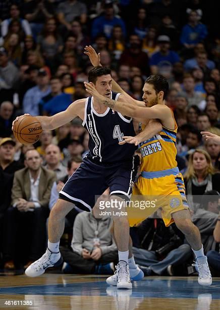 =Denver Nuggets shooting guard Evan Fournier plays tough defense on Oklahoma City Thunder power forward Nick Collison during the first quarter...