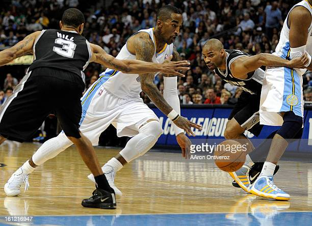 Denver Nuggets shooting guard JR Smith drives past San Antonio Spurs point guard George Hill during the second half on Wednesday March 23 2011 at the...