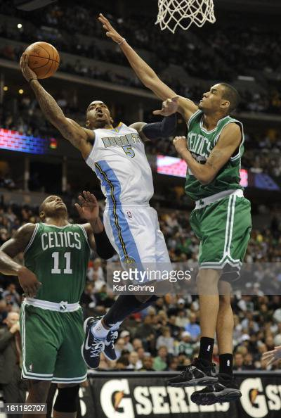 Denver Nuggets shooting guard JR Smith took a shot between Boston Celtics power forward Glen Davis and forward Chris Johnson in the second quarter...